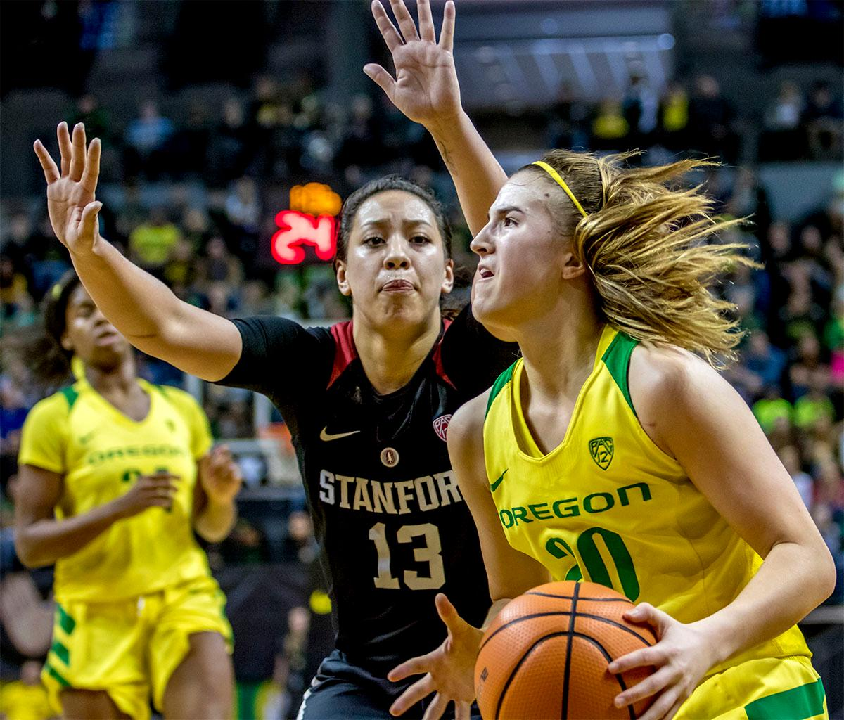 The Duck's Sabrina Ionescu (#20) looks for a path to the basket. The Stanford Cardinal defeated the Oregon Ducks 78-65 on Sunday afternoon at Matthew Knight Arena. Stanford is now 10-2 in conference play and with this loss the Ducks drop to 10-2. Leading the Stanford Cardinal was Brittany McPhee with 33 points, Alanna Smith with 14 points, and Kiana Williams with 14 points. For the Ducks Sabrina Ionescu led with 22 points, Ruthy Hebard added 16 points, and Satou Sabally put in 14 points. Photo by August Frank, Oregon News Lab