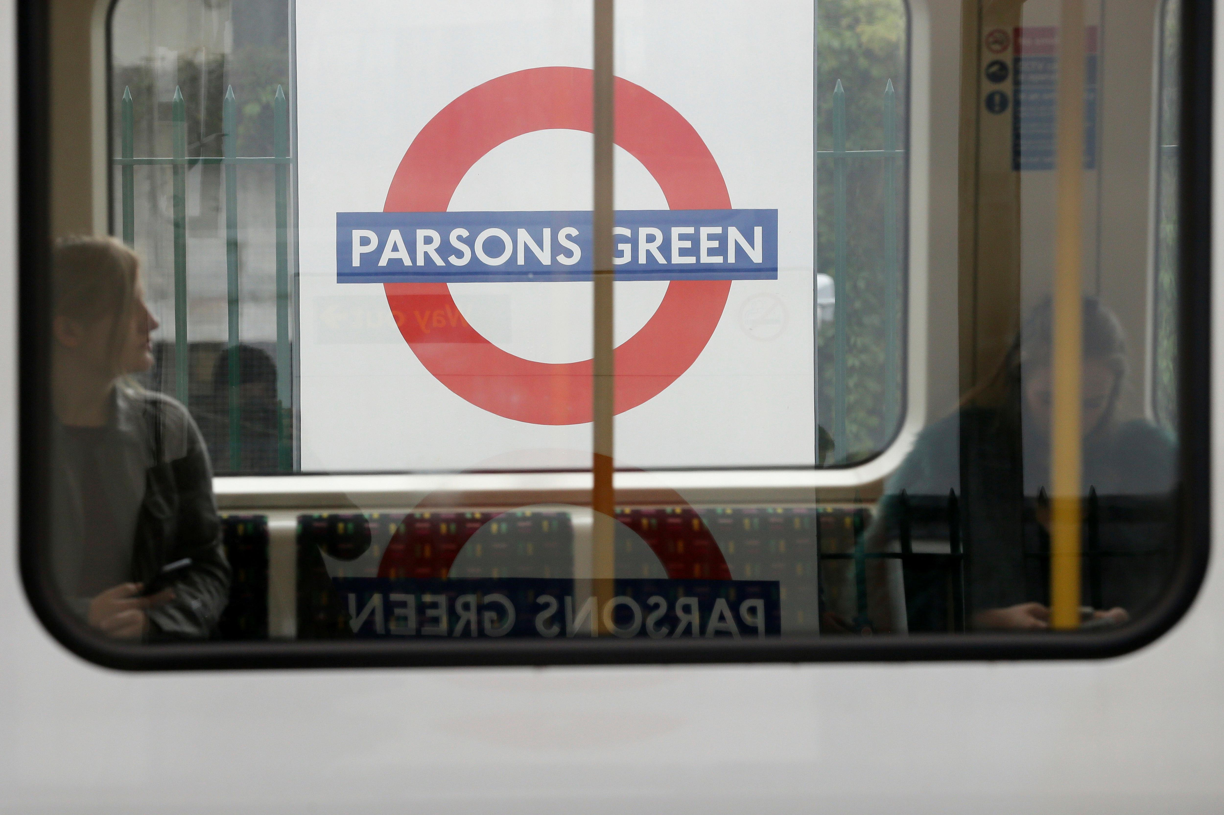 Passengers on a train at Parsons Green subway station after it was reopened following a terrorist attack on a train at the station yesterday in London, Saturday Sept. 16, 2017. British authorities are searching for suspects in the London subway blast that injured more than two dozen people as hundreds of soldiers are being deployed across the country. (AP Photo/Tim Ireland)