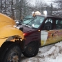School bus with kids on board collides with vehicle stuck in snow