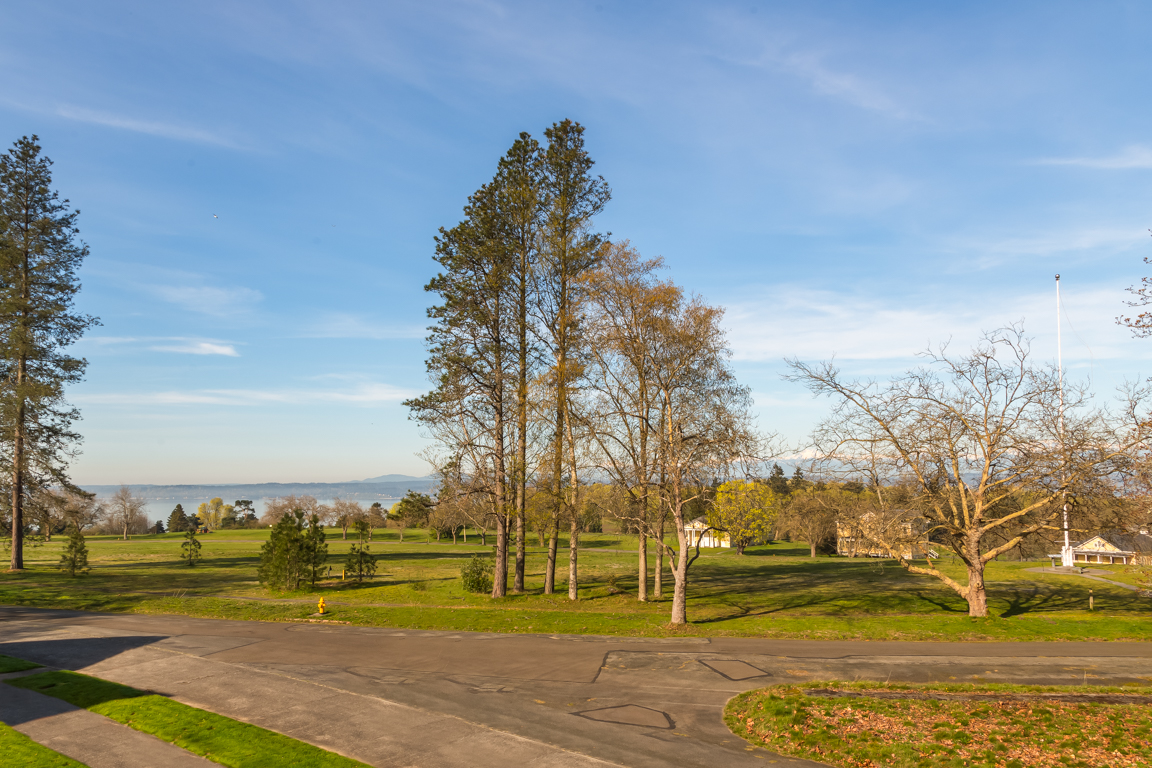 The view from the front door and covered patio looks out to Discovery Park, Seattle's largest public park, with 11.8 miles of walking trails, beaches, the historic West Point Lighthouse and natural wildlife.