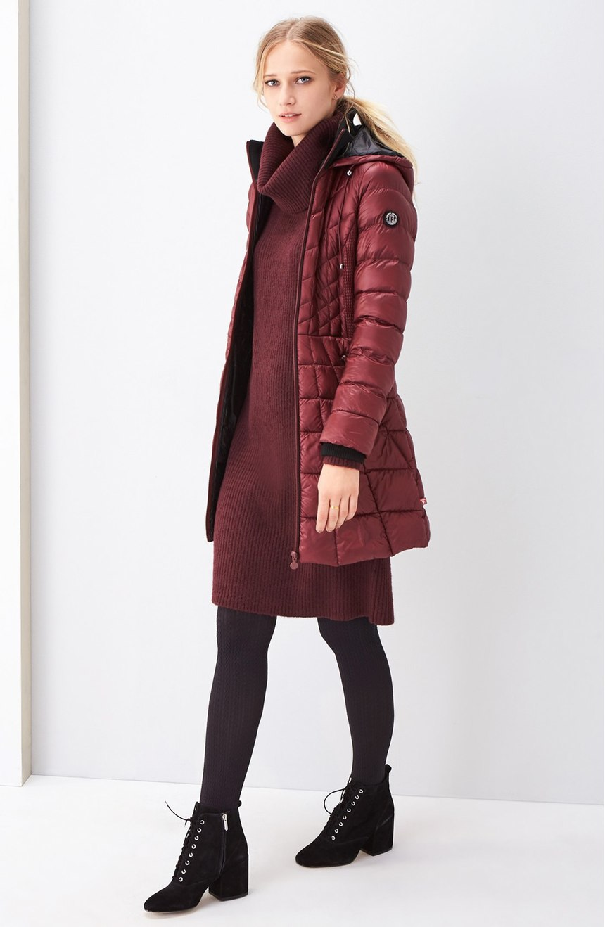 This long puffer coat is fall in a nutshell.  Berry is the new black and go-to color this season.    When temperatures drop, it doesn't mean your outfit has  to be all doom and gloom like the weather.  You can still look effortless in the rain! From high-fashion puffers to cozy parkas and knee high (high fashion) waterproof boots, these are the styles to invest in NOW.  (Image: Nordstrom)