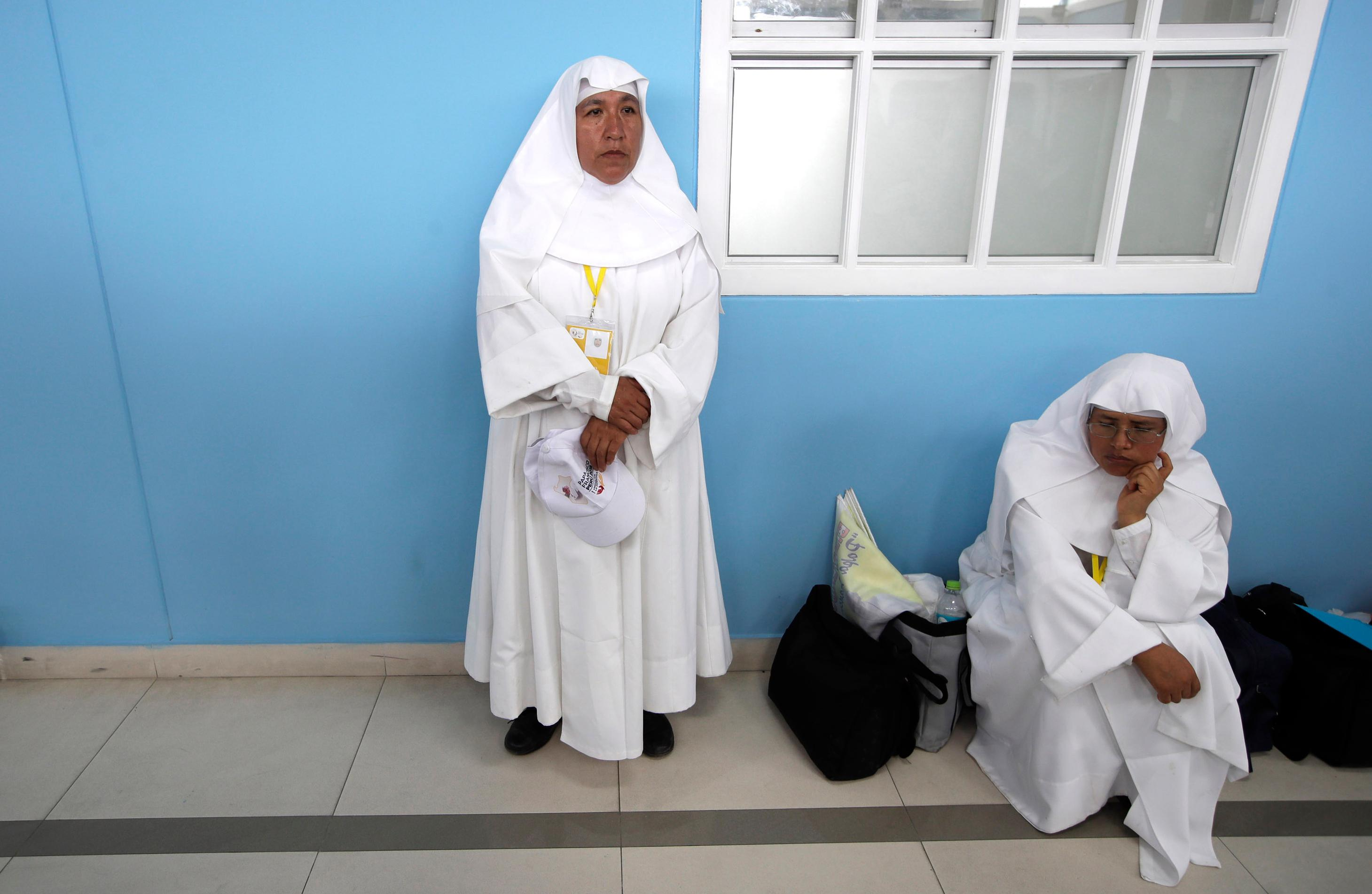 Nuns listen to Pope Francis during his meeting with the priests, religious men and women, and seminarians of the ecclesiastical provinces of Northern Peru in the St. Carlos and Marcelo College, in Trujillo, Peru, Saturday, Jan. 20, 2018. Francis is the second pope to visit the coastal city, which is periodically drenched by disastrous rains caused by a warming of Pacific Ocean waters. (AP Photo/Alessandra Tarantino)