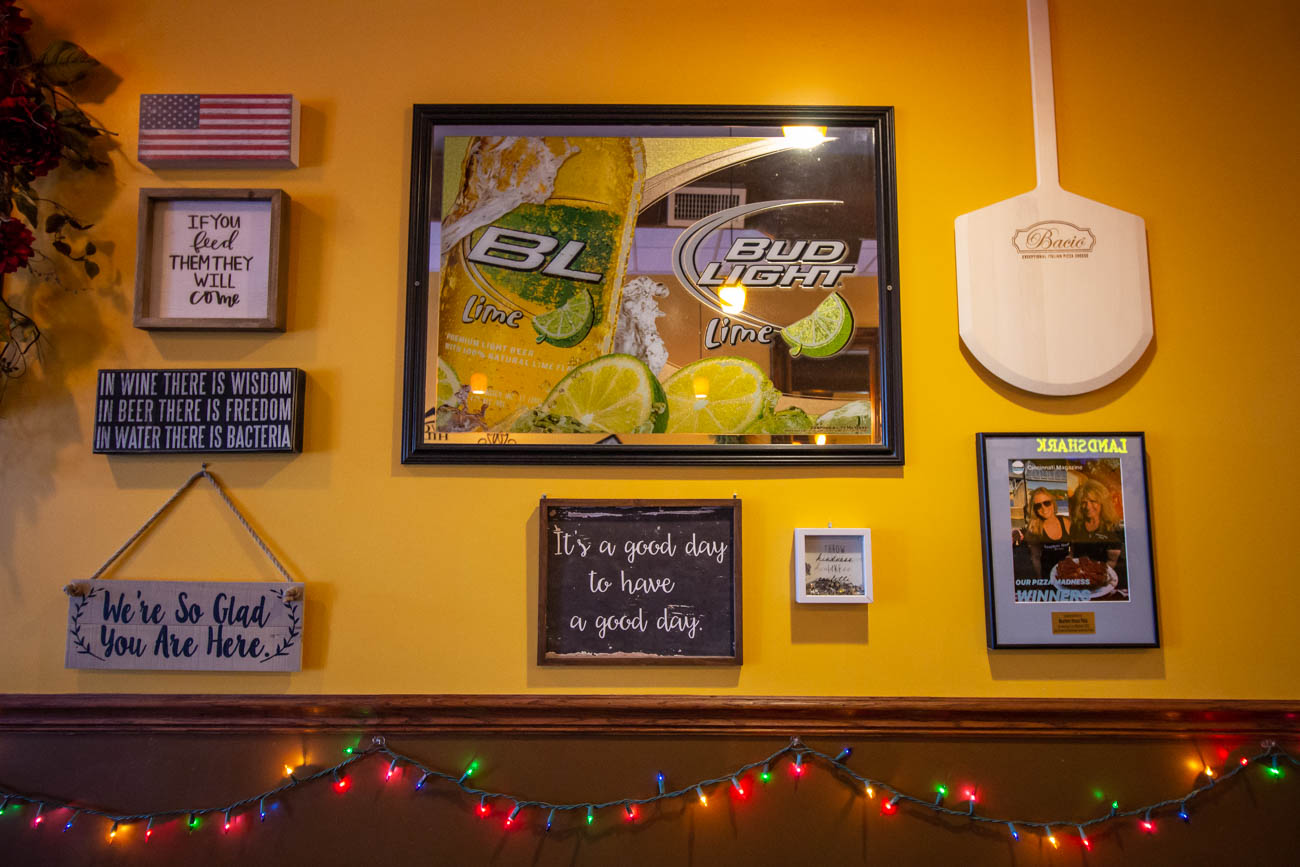 There is some great signage covering the walls of the warm and friendly joint. / Image: Katie Robinson, Cincinnati Refined // Published: 1.9.20