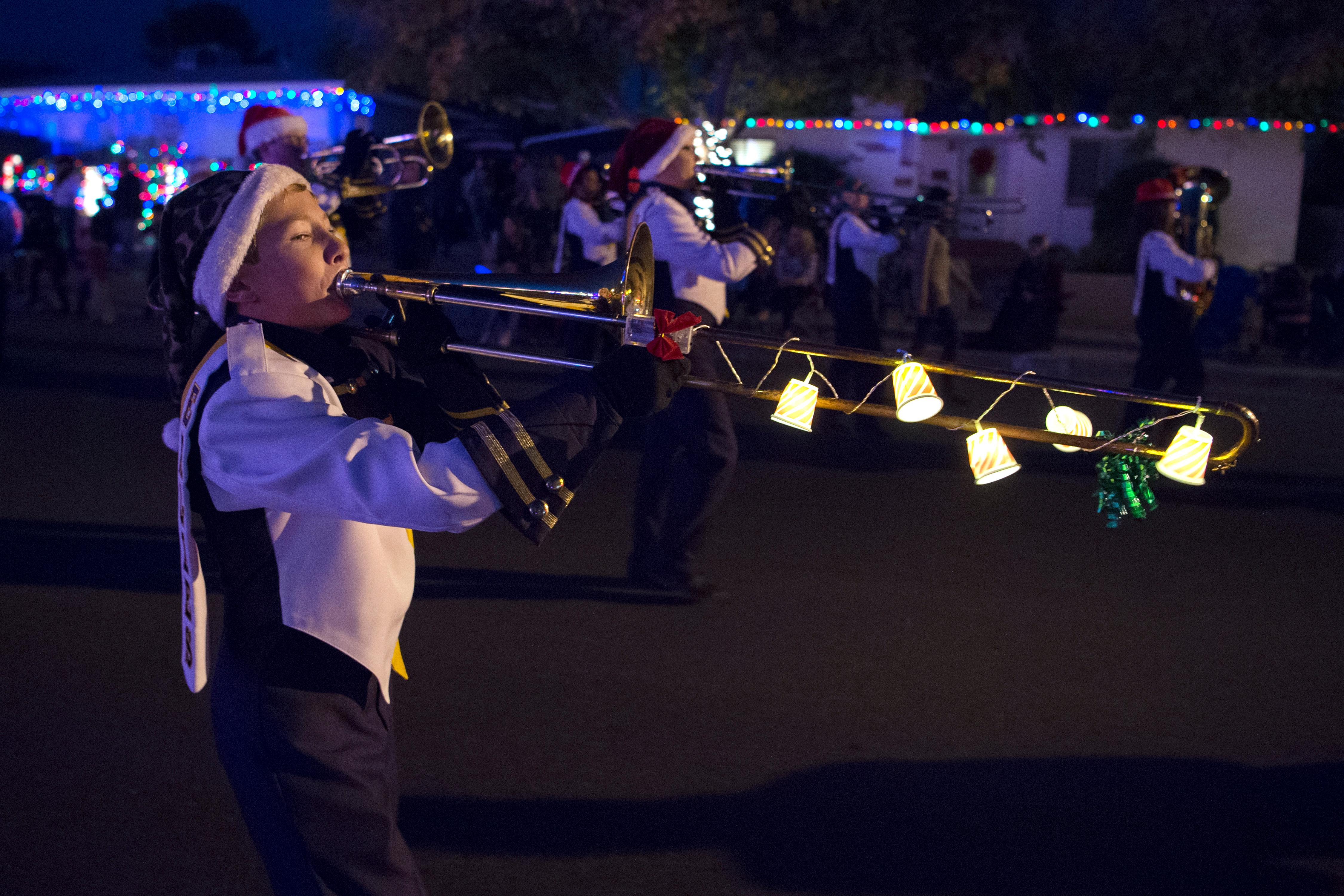 A Boulder City High School trombone player decorates her horn with lights during the Santa's Electric Parade Saturday, December 2, 2017, in Boulder City. [Sam Morris/Las Vegas News Bureau]