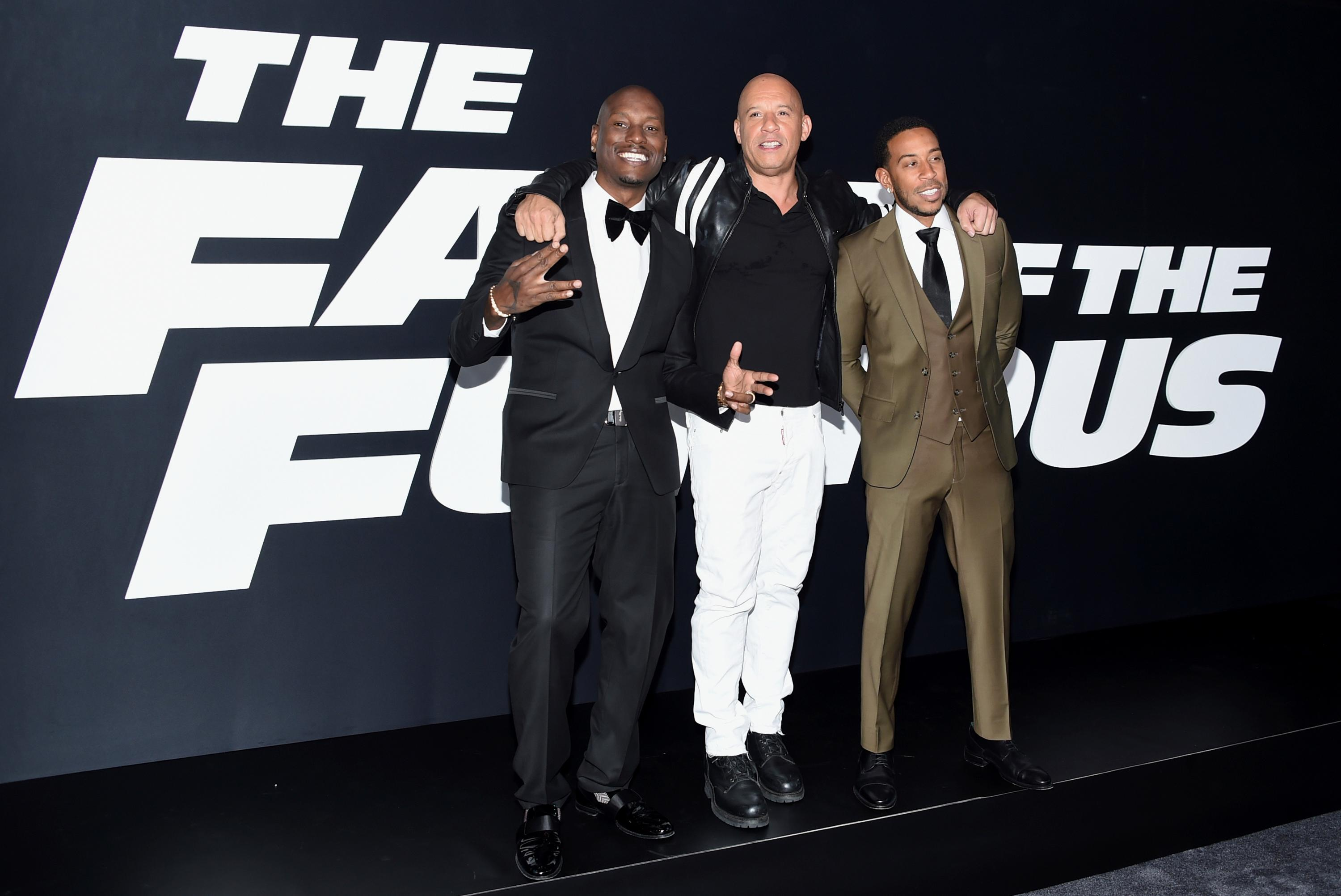 "FILE - In this April 8, 2017 file photo, Tyrese Gibson, from left, Vin Diesel and Ludacris attend the world premiere of ""The Fate of the Furious"" in New York. The ""Fast and the Furious"" is putting the brakes on the ninth installment in the franchise. Universal Pictures said Wednesday that the film's release will move back a year to April 10, 2020. It was originally set for release in April 2019. The studio did not offer a reason for the shift.(Photo by Evan Agostini/Invision/AP, File)"