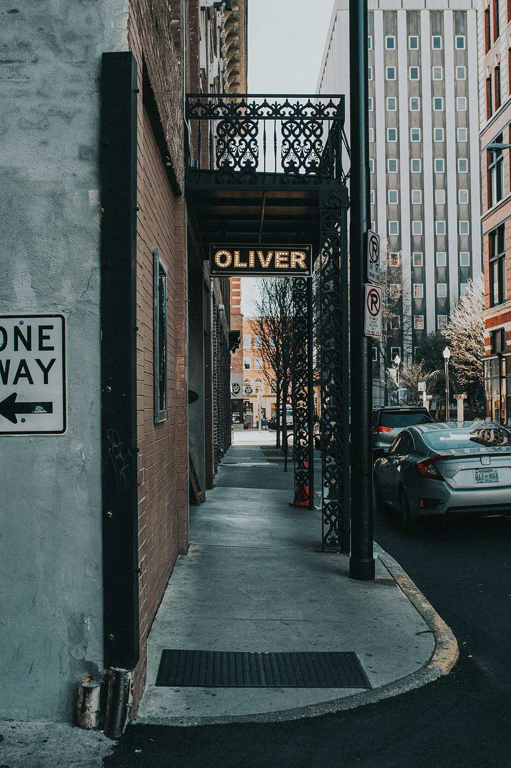 "PICTURED: The Oliver Hotel / ABOUT: Knoxville is nicknamed ""the Queen City of the Mountains."" At only a three and a half hour drive down I-75, take a day trip down and check out everything the city has to offer. Then, head southeast and enjoy the American wilderness that lies just beyond it. / Image: Brianna Long // Published: 2.5.17"