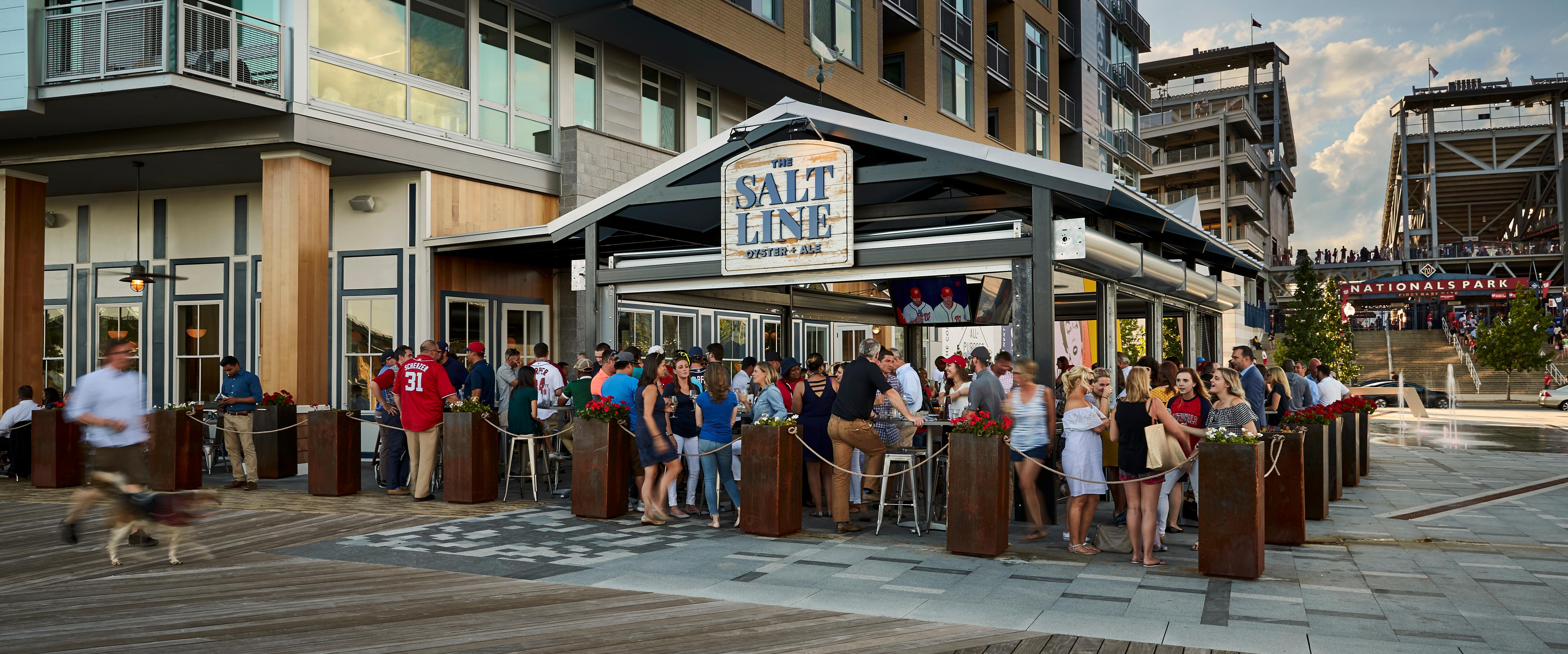 This Thursday, March 1, we can finally start pretending its spring, and that dining outside will be in the cards again, as The Salt Line will fully open its outdoor bar for the season. (Image: Greg Powers){ }