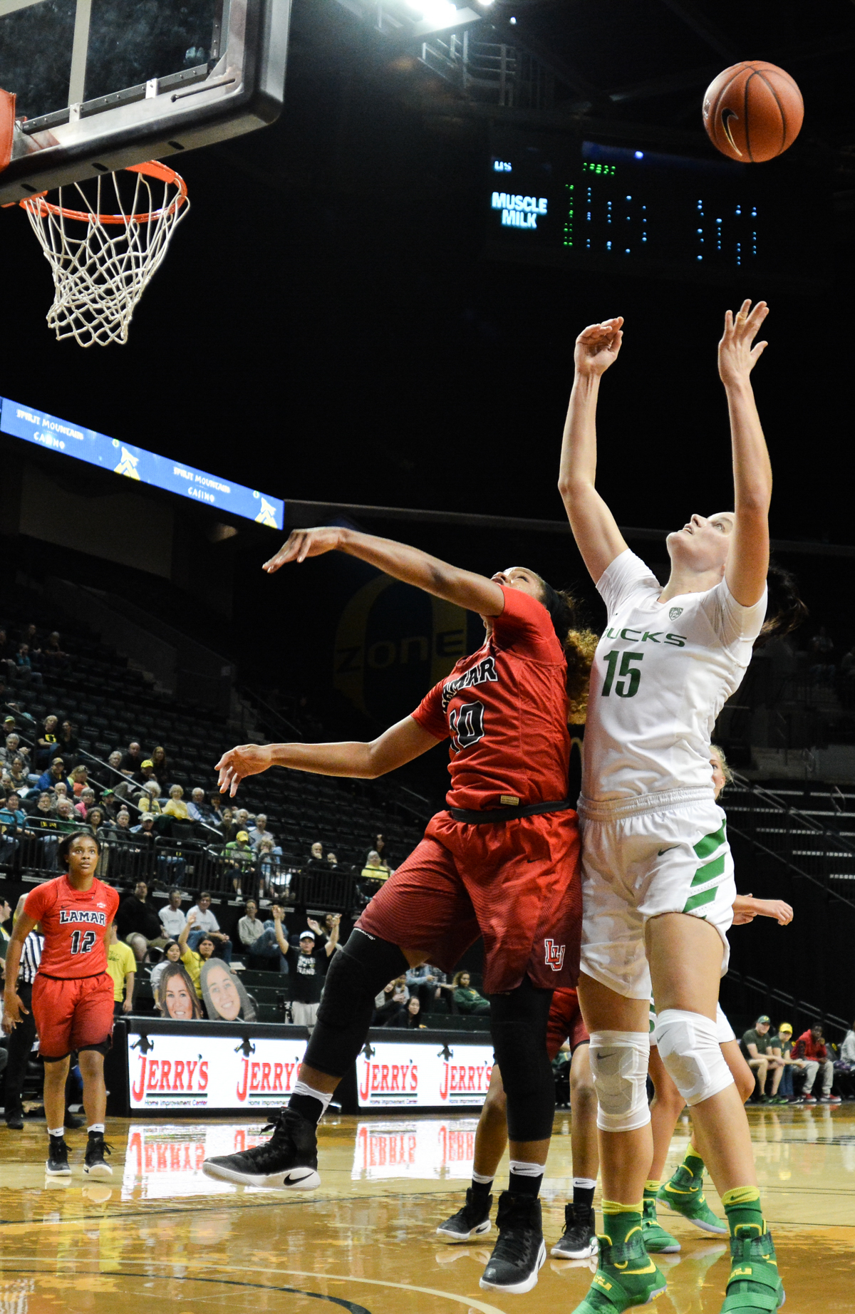 Ducks Jacinta Vandendberg (#15) and Cardinals DeJa Roberts (#10) battle over the rebound. The Oregon Ducks women's basketball team won their season opener against the Lamar Cardinals 84-67. Photo by Jacob Smith, Oregon News Lab