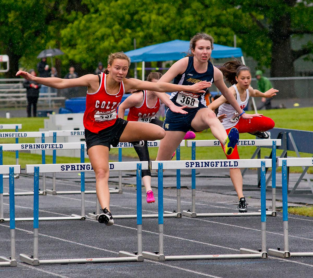 Tara Crosswhite from Thurston wins the 100 meter hurdles with a time of 16.17 at the 5A-3 Midwestern League District Track Meet. Photo by Dan Morrison, Oregon News Lab