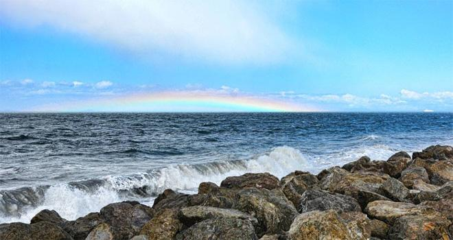 Rainbow spotted low on the horizon from Port Angeles' Ediz Hook Wednesday afternoon. Coho ferry is on the right. Photo: Jay R. Cline