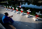 Orlando night club victim memorial crosses.jpg