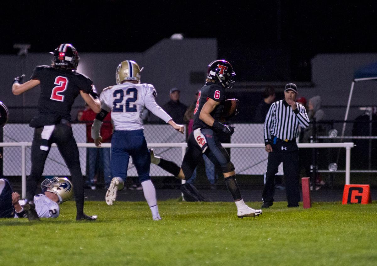Thurston Colts wide receiver JJ Sargeant (#6) powers into the end zone for a score against the Marist Spartans. Thurston defeated Marist 50 to 14 to seal the second position in their conference. Photo by Dan Morrison, Oregon News Lab