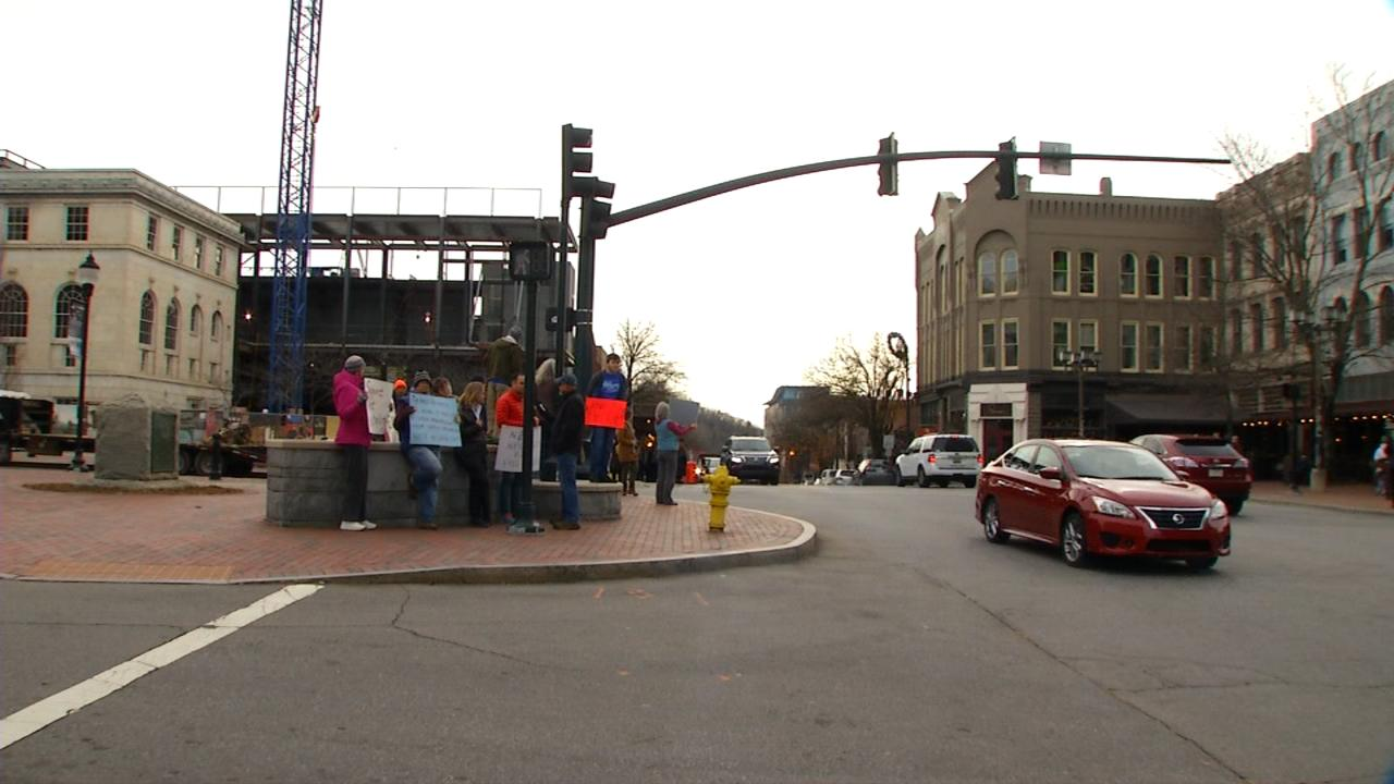A small group of protesters gathered Thursday afternoon in Asheville to voice their support for net neutrality. (Photo credit: WLOS staff)