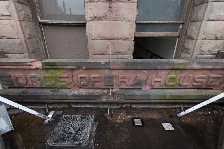 The original sign is embedded in a section of the building's stone facade and is obscured today by the triangular marquee that hangs above the front entrance. / Image: Phil Armstrong, Cincinnati Refined // Published: 3.17.18