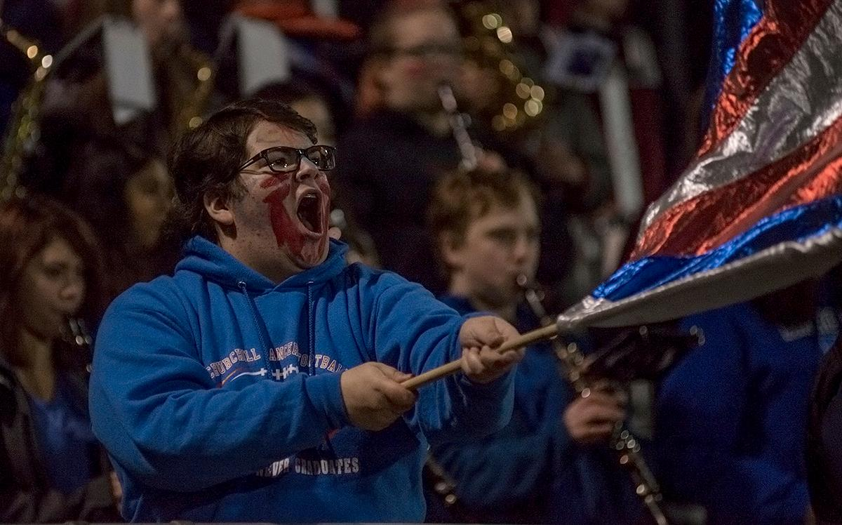A Churchill Lancers fan cheers on the team. The Churchill Lancers defeated the Mountain View Cougars 35-28 on Saturday night at Liberty High School, securing a spot in the 5A state championship. Photo by Abigail Winn, Oregon News Lab