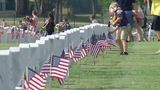 Boy Scouts, Girl Scouts pay respects to fallen service members at local national cemetery