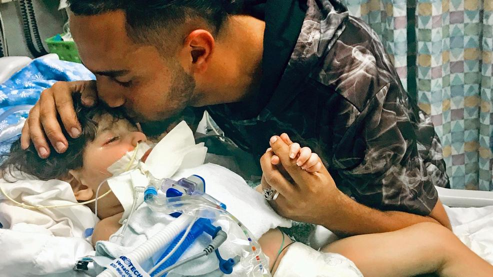 17, 2018, by the Council on American-Islamic Relations in Sacramento,  Calif., Ali Hassan kissing his dying 2-year-old son Abdullah in a  Sacramento ...
