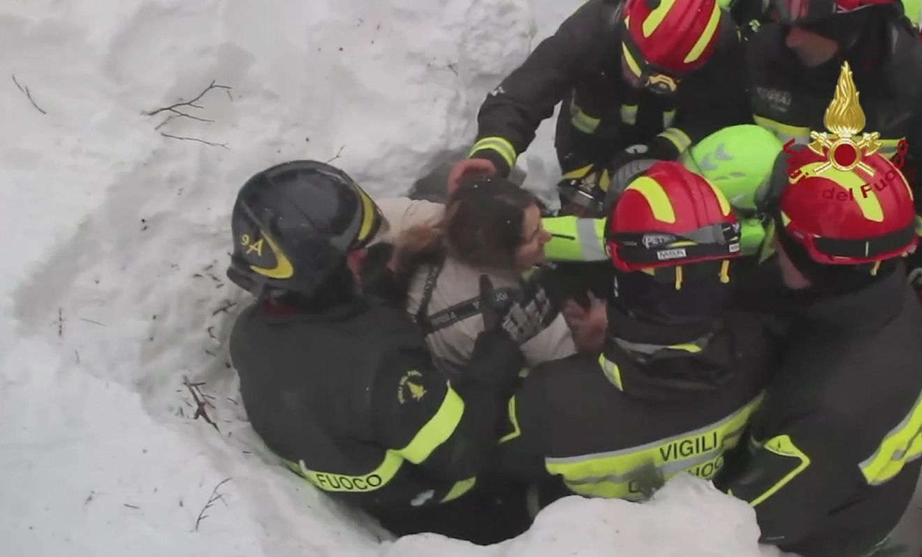 Rigopiano hotel avalanche first funerals as search goes on bbc news - This Frame From Video Shows Italian Firefighters Extracting A Woman Alive From Under Snow And Debris