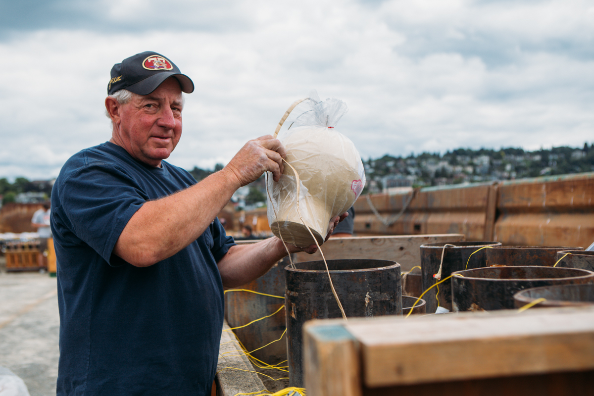 Before fireworks fly over Lake Union on July 4th, Western Display Fireworks LTD, set up over 7,000 pounds of fireworks to be set off. The process takes multiple days and a whole team of professionals. July 3rd, 2014. (Joshua Lewis / Seattle Refined)