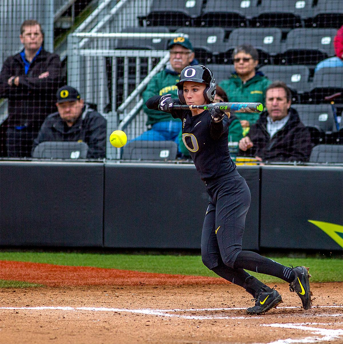 The Duck's Alexis Mack (#10) connects with the ball in a bunt as she prepares to make her run for first. The Oregon Ducks defeated the Cal Golden Bears 2-1 in the second game of the three game series. Photo by August Frank, Oregon News Lab