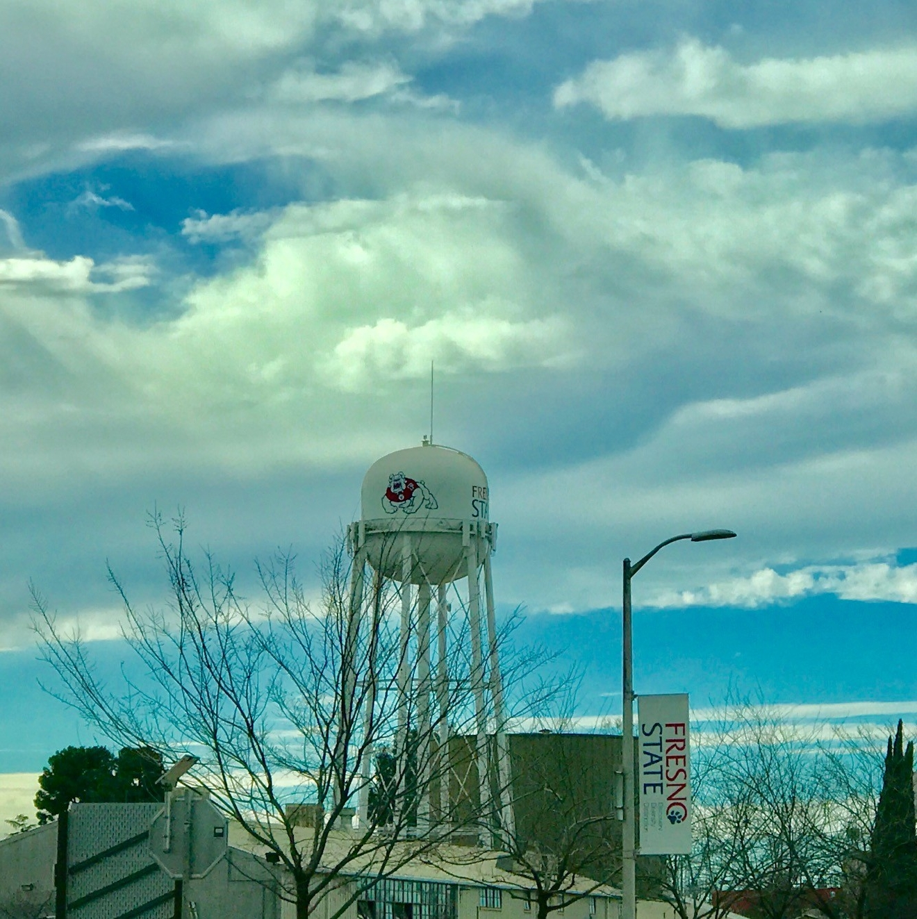 Sunlight and clouds above the Fresno State water tower by Traci Obata 2-16-17