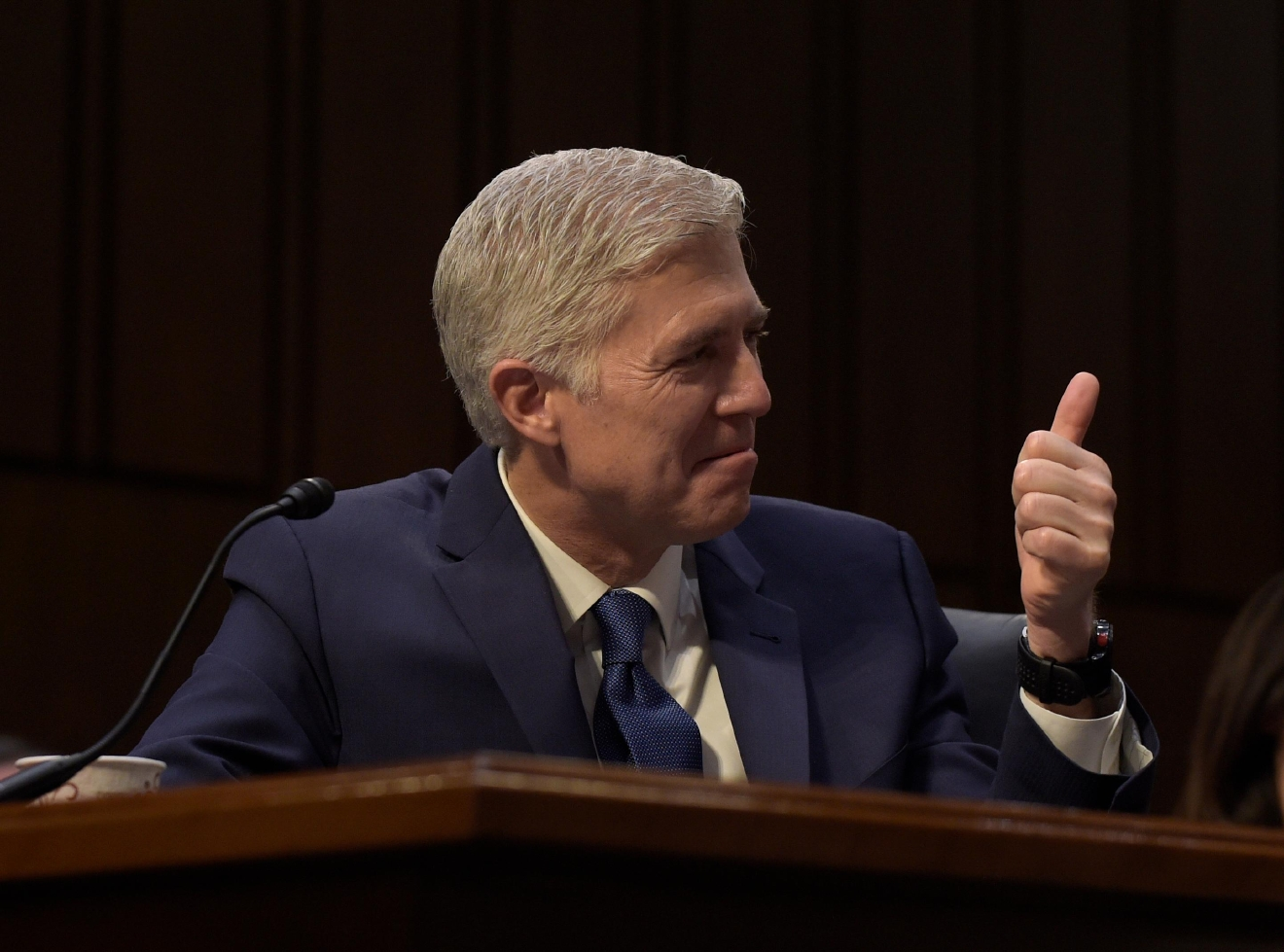 Supreme Court Justice nominee Neil Gorsuch gives a thumbs-up when asked how he is doing as he listens to opening statements on Capitol Hill in Washington, Monday, March 20, 2017, during his confirmation hearing before the Senate Judiciary Committee. (AP Photo/Susan Walsh)
