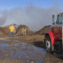 Fire crews battle large burr pile fire in Tulia