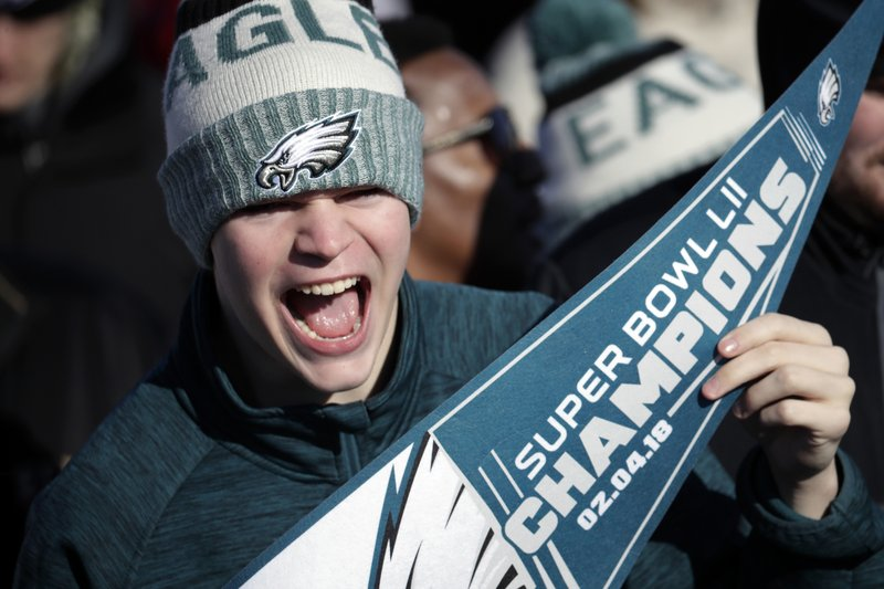 <p>A Philadelphia Eagles fan chants while waiting for the team to arrive at Philadelphia International Airport a day after defeating the New England Patriots in Super Bowl 52 in Minneapolis, Monday, Feb. 5, 2018. (AP Photo/Julio Cortez)</p>