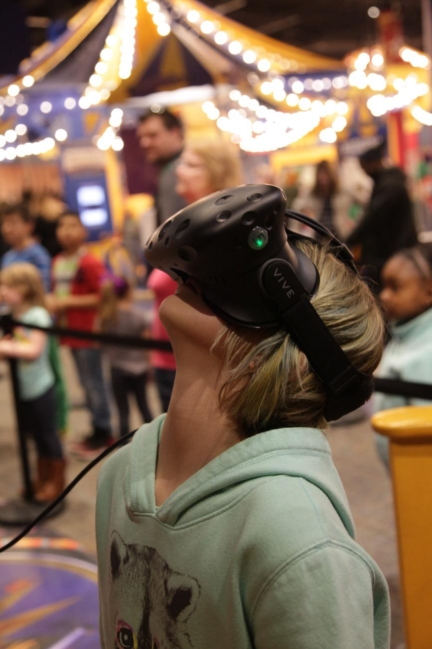 A girl explores the big top after a virtual reality tightrope walk in the museum's Circus-themed 'Starring YOU!' exhibit / Image: Chez Chesak // Published: 4.2.19