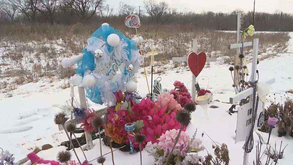 Friends and family of Reagan Tokes placed flowers and signs of remembrance at the site of her death. (WSYX/WTTE)