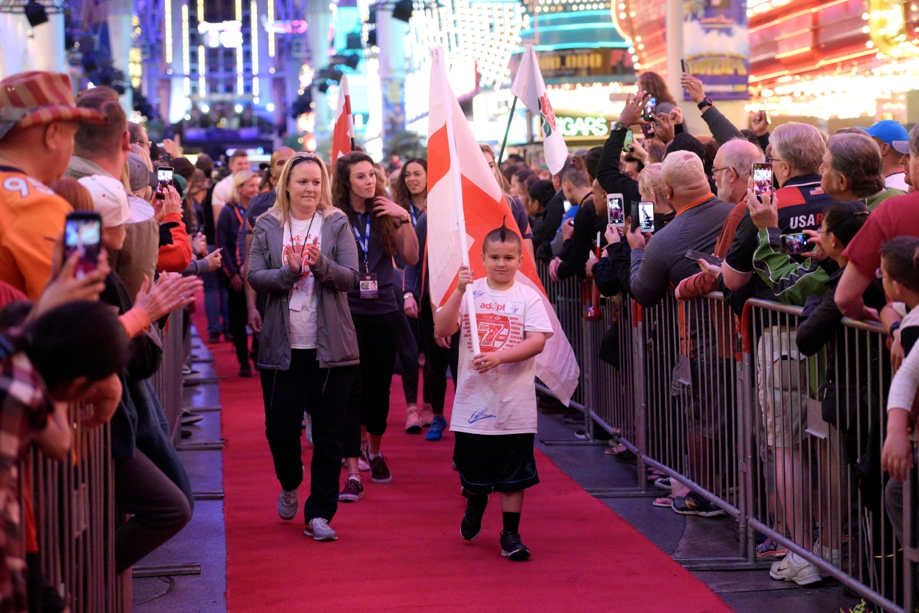 "The English team makes its way down a red carpet during the USA Sevens rugby ""Parade of Nations"" Thursday, March 3, 2017, at the Fremont Street Experience. CREDIT: Sam Morris/Las Vegas News Bureau"