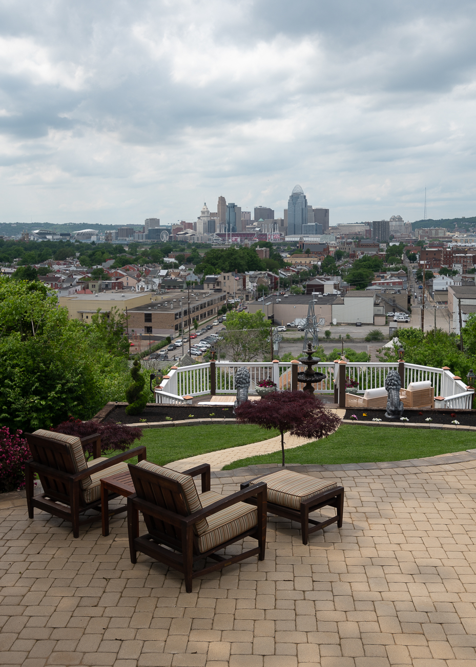There are three tiers to David's backyard: the first deck just off the kitchen, a patio below it, and another deck below the patio. Each has its own water and fire feature with a panoramic view of everything from west Covington to East Walnut Hills. / Image: Phil Armstrong, Cincinnati Refined // Published: 5.31.19