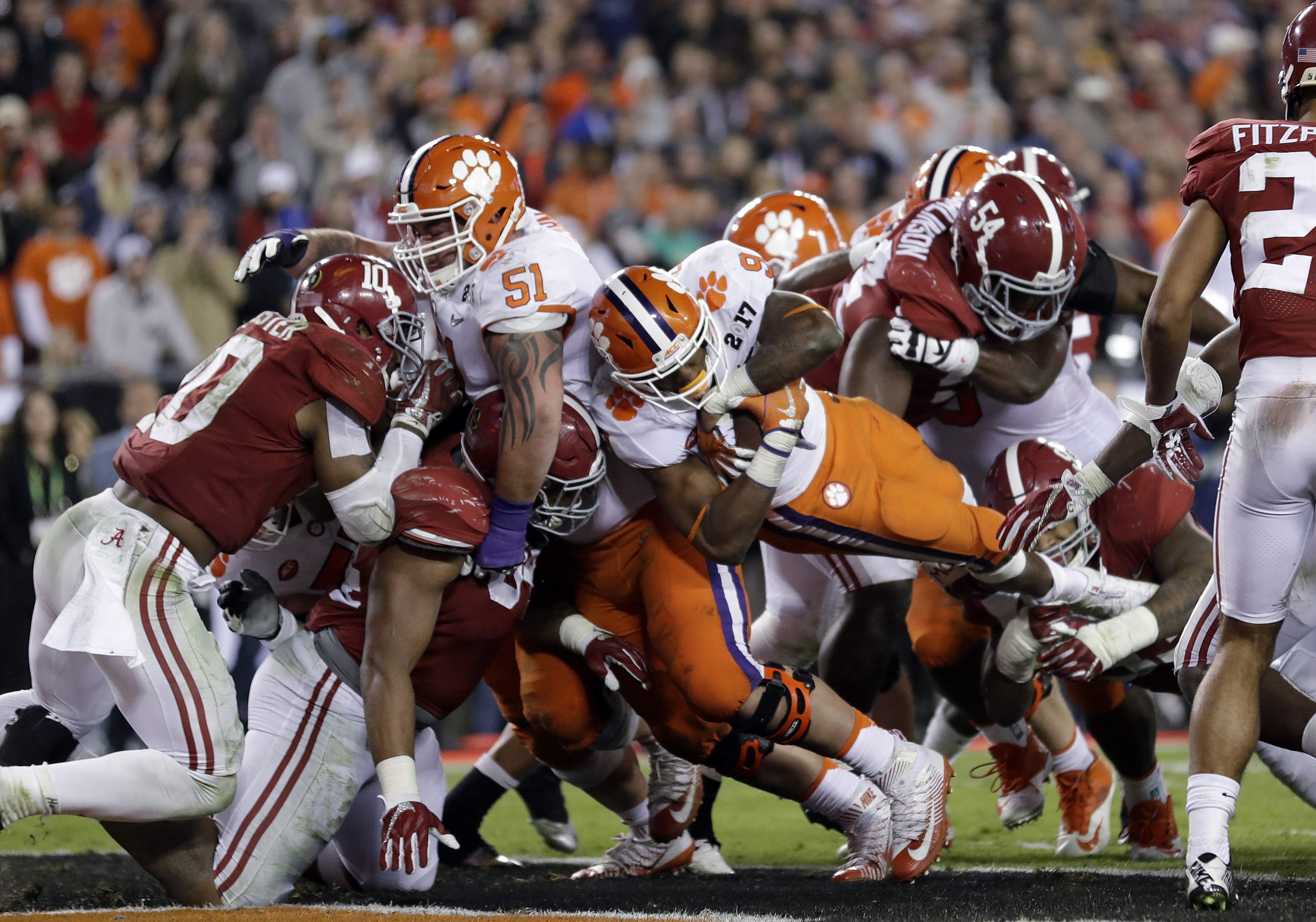 Clemson's Wayne Gallman (9) dives into the end zone for a touchdown turn during the second half of the NCAA college football playoff championship game against Alabama early Tuesday, Jan. 10, 2017, in Tampa, Fla. THE ASSOCIATED PRESS