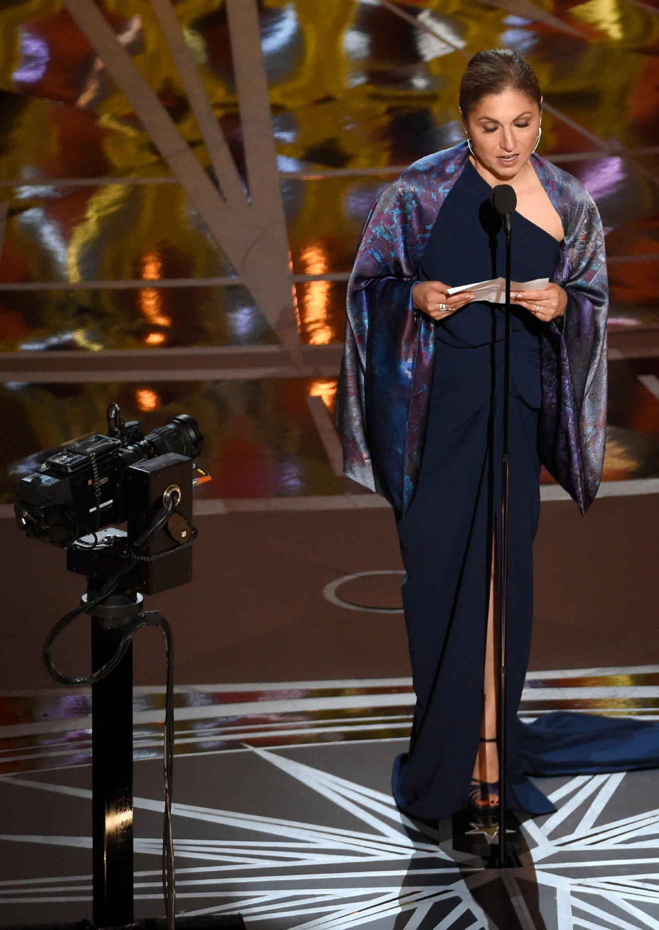 "Anousheh Ansari accepts the award for best foreign language film for ""The Salesman"" on behalf of Asghar Farhadi at the Oscars on Sunday, Feb. 26, 2017, at the Dolby Theatre in Los Angeles. (Photo by Chris Pizzello/Invision/AP)"