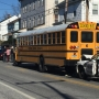 Police on scene of school bus hit by car