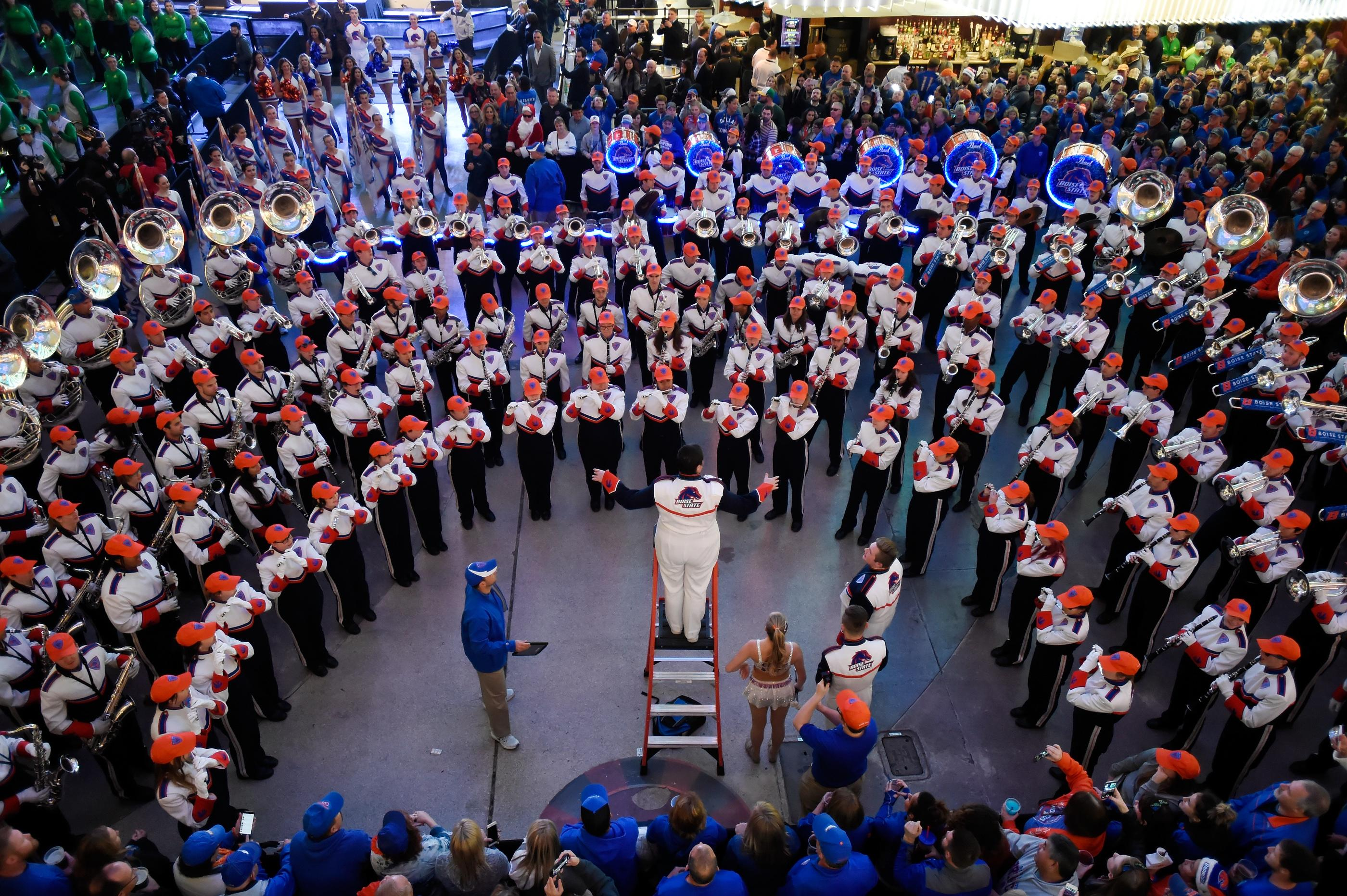 The Boise State marching band participates during a pep rally at the Fremont Street Experience Friday, Dec. 15, 2017, in Las Vegas. The Boise State Bronco will take on the Oregon Ducks in the 26th edition of the Las Vegas Bowl at Sam Boyd Stadium on Saturday. CREDIT: David Becker/Las Vegas News Bureau