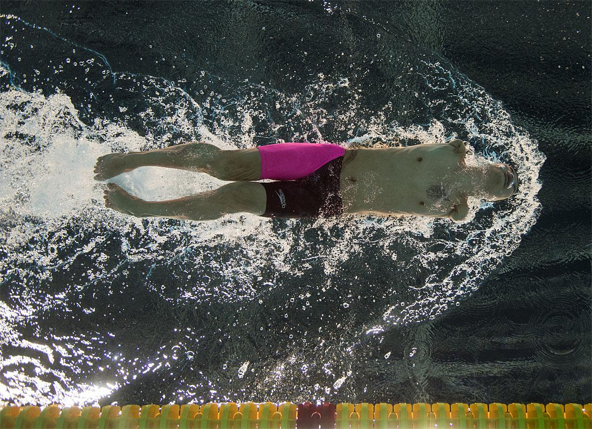 In this photo provided by the IOC, Tao Zheng, of China, competes in heat 2 of the men's 50-meter freestyle S6 swimming event at the Olympic Aquatics Stadium during the Paralympic Games, in Rio de Janeiro, Brazil, Friday, Sept. 9, 2016. (Bob Martin/OIS,IOC via AP)