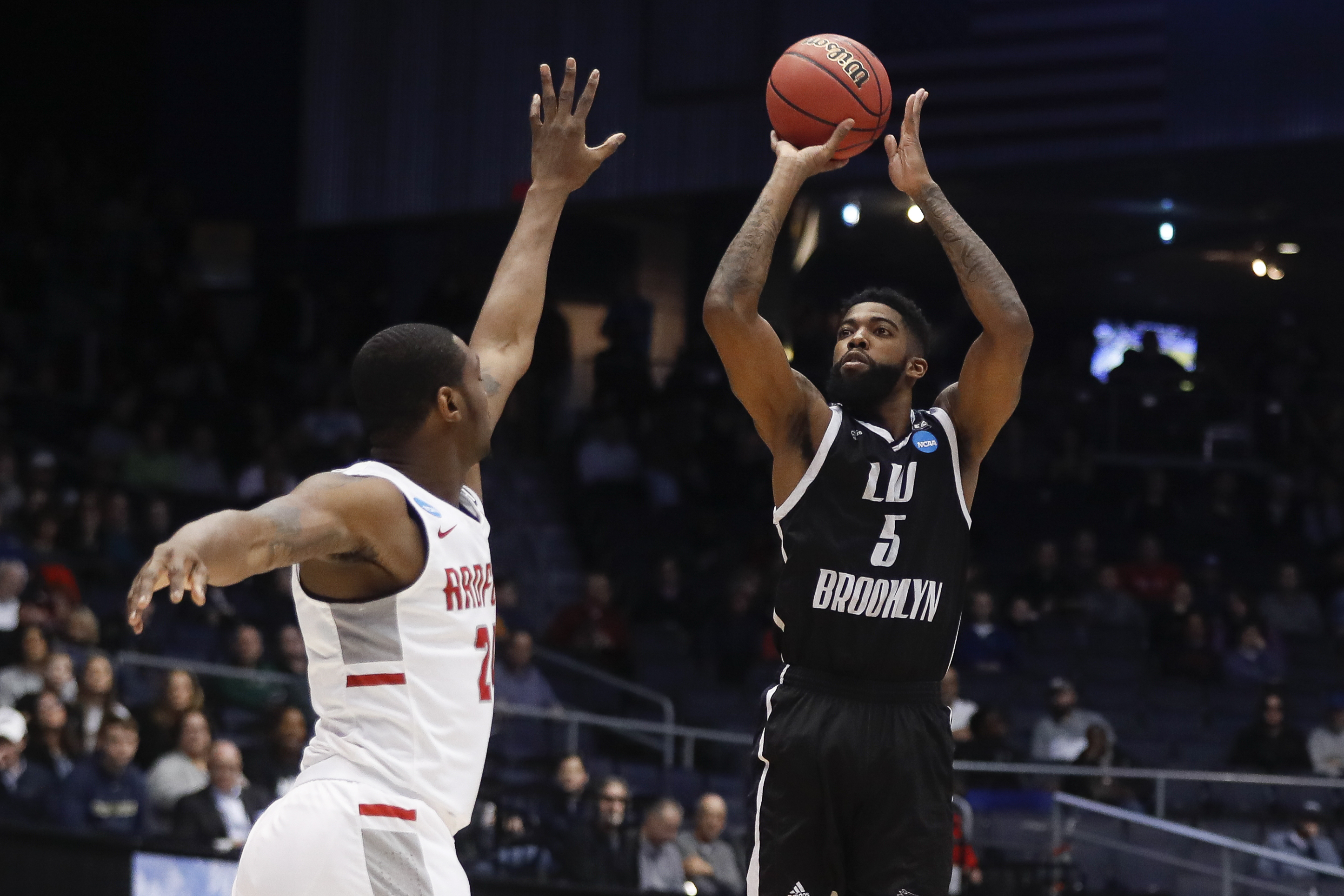 LIU Brooklyn's Zach Coleman (5) shoots against Radford's Ed Polite Jr. during the first half of a First Four game of the NCAA men's college basketball tournament, Tuesday, March 13, 2018, in Dayton, Ohio. (AP Photo/John Minchillo)