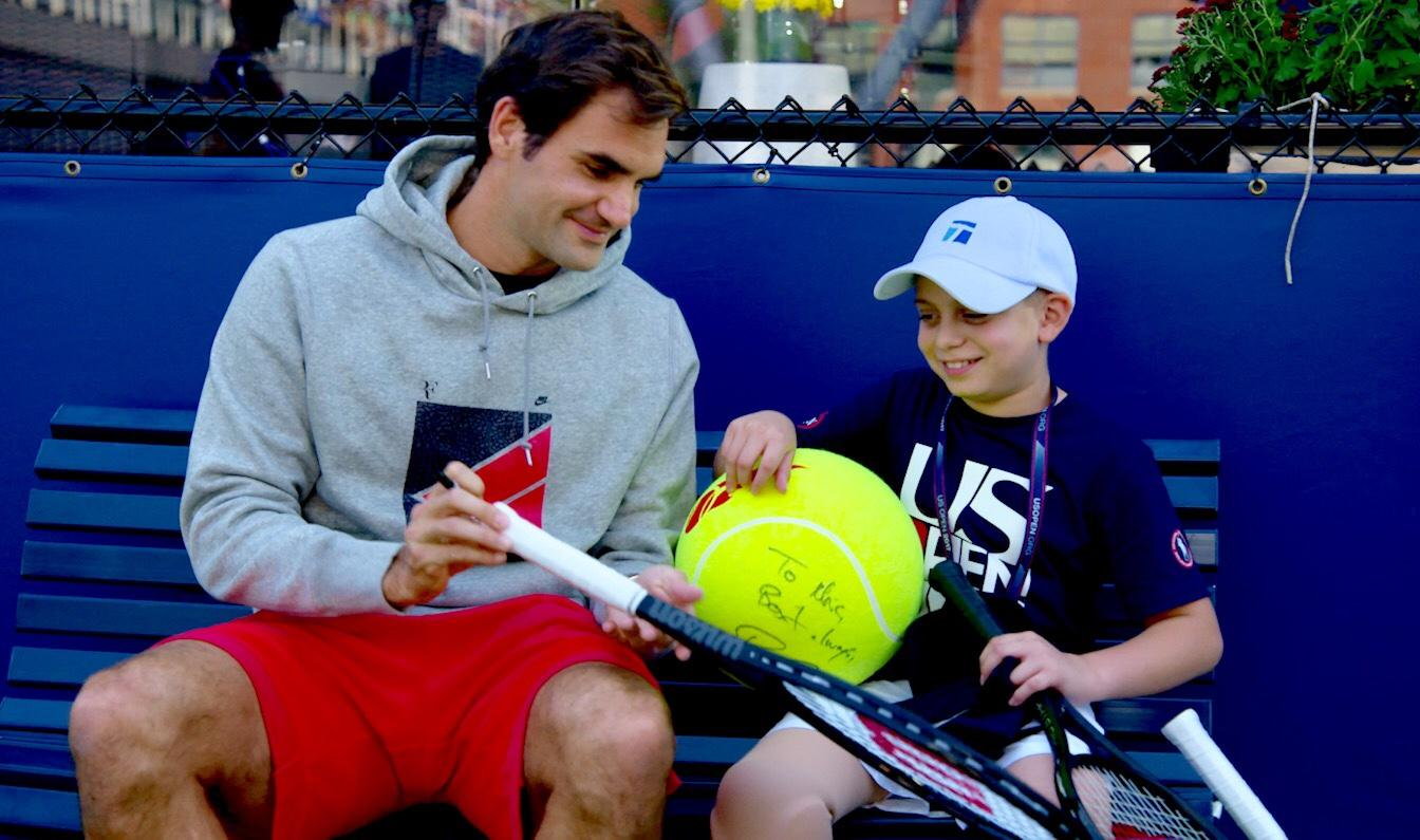 Cancer surviver Marc Krajekian meets his hero Roger Federer