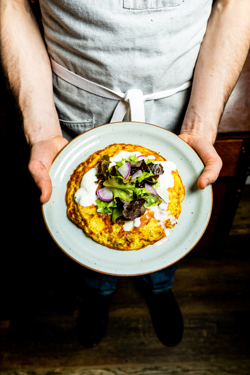Roasted broccoli frittata with Yukon potatoes, Parmesan cheese, creme fraîche, and a herb salad / Image: Amy Elisabeth Spasoff // Published: 3.14.19