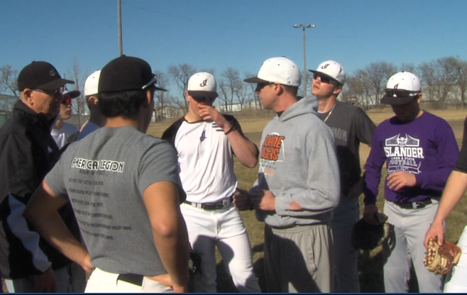 The Grand Island baseball team meets during one of their practices (KHGI)