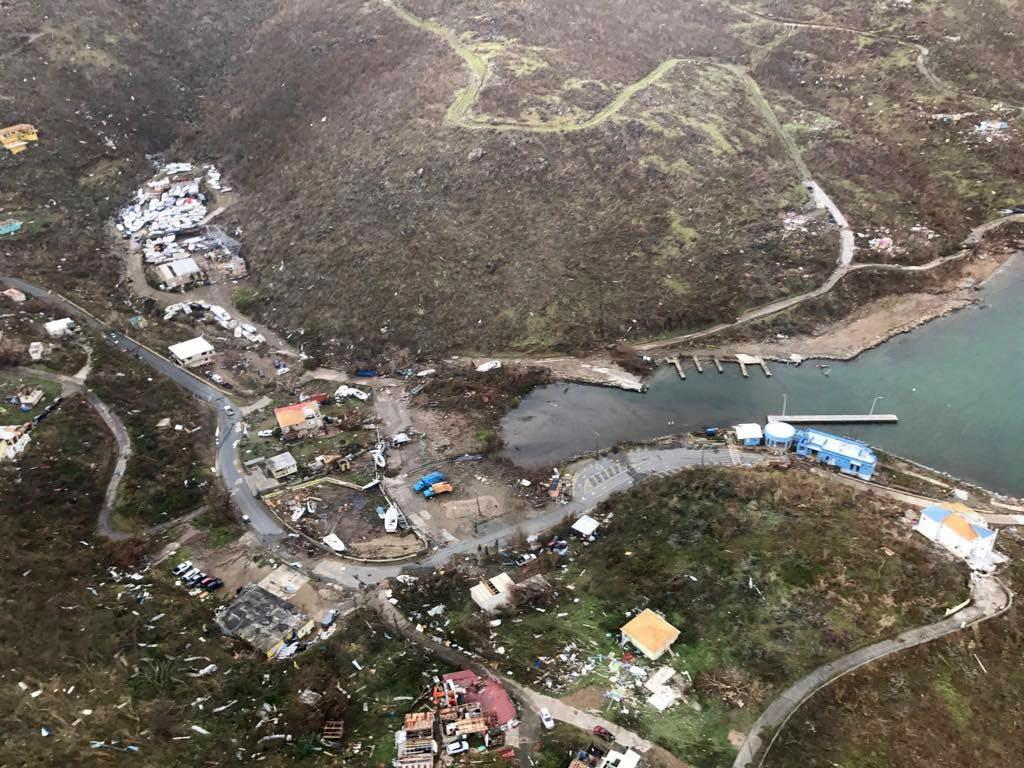 This photo provided on Friday, Sept. 8, 2017, shows storm damage in the aftermath of Hurricane Irma in Virgin Gorda's Gun Creek in the British Virgin Islands. Irma scraped Cuba's northern coast Friday on a course toward Florida, leaving in its wake a ravaged string of Caribbean resort islands strewn with splintered lumber, corrugated metal and broken concrete. (Caribbean Buzz Helicopters via AP)
