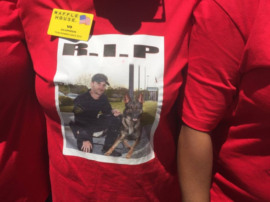 Employees of a local Waffle House went to Freeman's funeral wearing shirts with a picture of him and his K9 partner Bojar / David Johnson (WGXA)