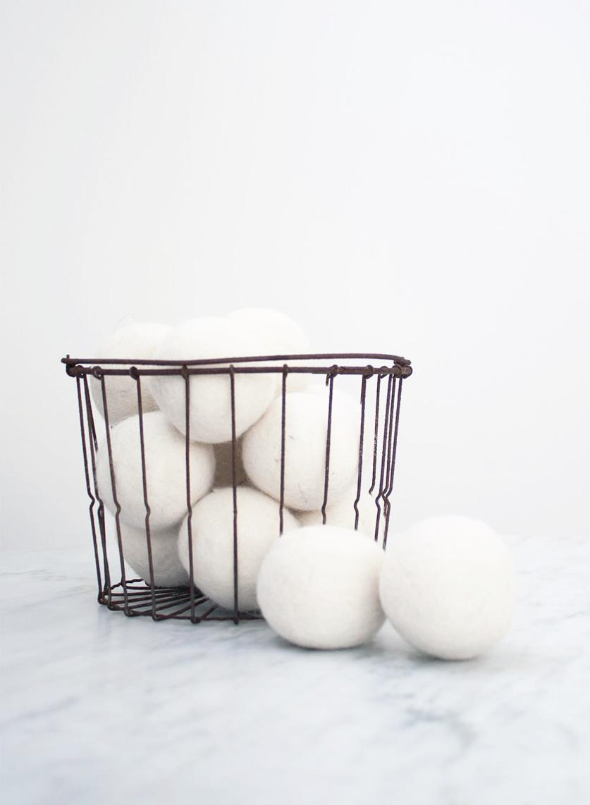 "Forget chemical laden dryer sheets, wool dryer balls are the new ""it"" laundry accessory! They help dry your clothes quicker by bouncing around and creating air pockets in your dryer, which in turn help to dry your clothes more evenly and quickly. Another perk: add three drops of essential oils to the dryer balls — try peppermint, eucalyptus, or lavender — to add a wonderful fresh scent to your clothes! https://bit.ly/2PLvAiT (Image: Ashley Hafstead)"