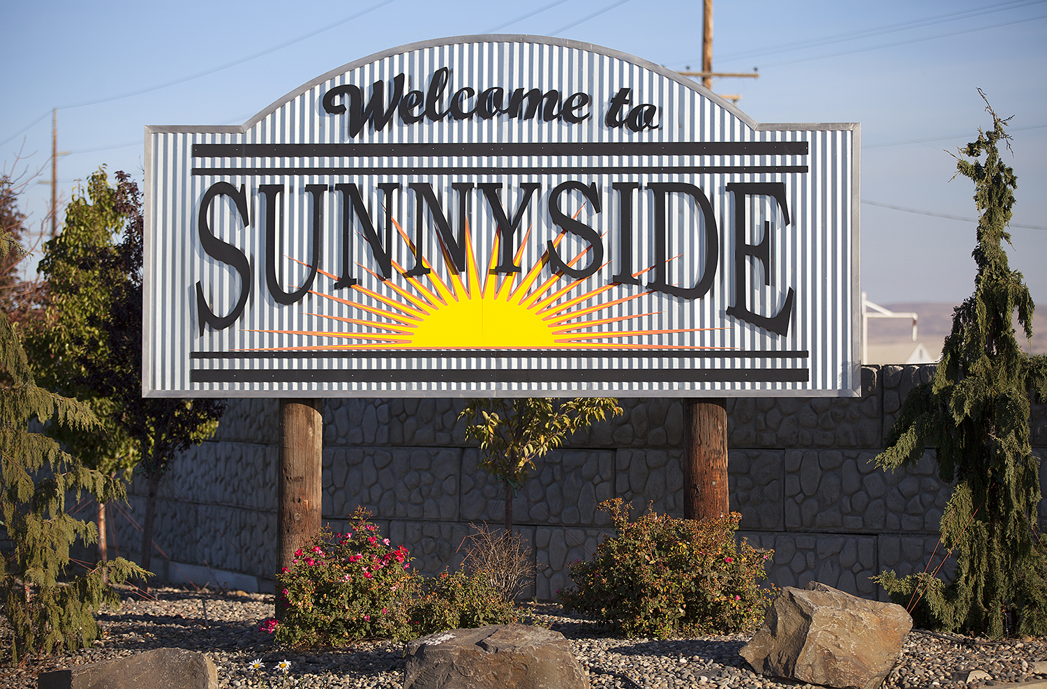 SUNNYSIDE. It's easy to focus on the destination rather than the journey, but that's only part of the story. There are so many exciting things to see along the way; the general store in a small town, a historical marker with information about an important event or a sign welcoming visitors into a town. Photographer Anthony May has been collecting Welcome signs from towns and cities he's visited for over nine years and across several states. This gallery focuses specifically on Washington. (Image: Anthony May / Seattle Refined)