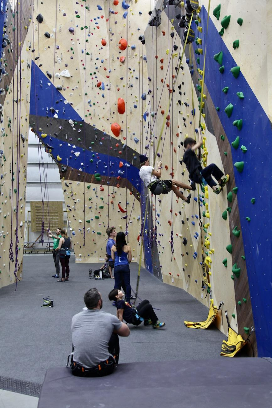 Climbers work their way up beginner routes with the use of some of the gym's eight autobelay devices. The devices will catch a falling climber and eliminate the need for a human partner to belay them. / Image: Chez Chesak // Published: 2.1.20