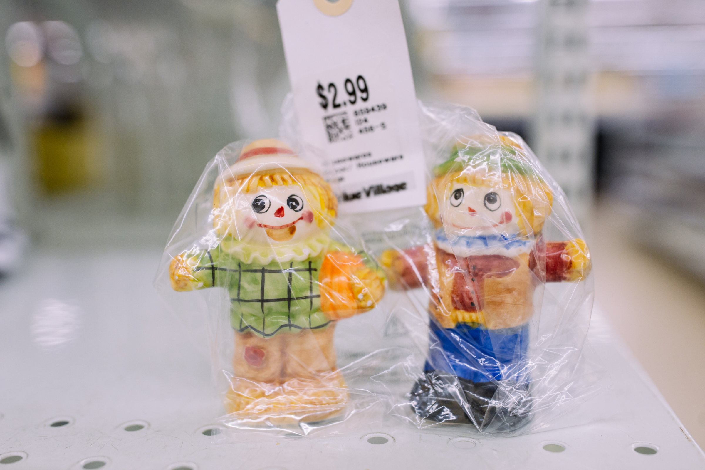 Scare crow salt and pepper shakers. $2.99  Are you going to a White Elephant Gift Exchange this year? We headed to our local Value Village to give you some gift ideas and how much they cost. (Image: Joshua Lewis / Seattle Refined)