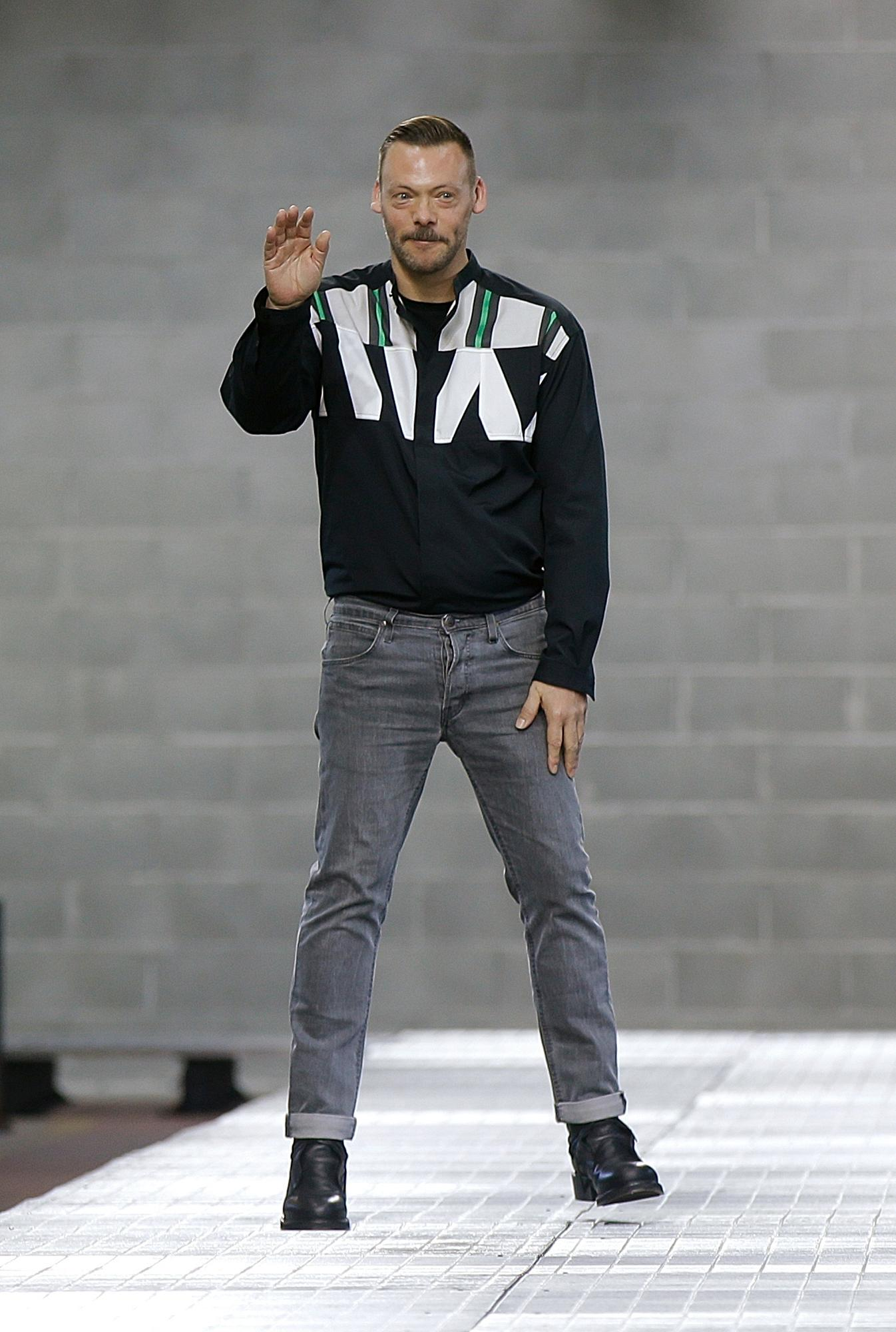 Creative Director Lee Wood waves to the audience at the end of the Dirk Bikkembergs men's Spring-Summer 2018 fashion show, that was presented in Milan, Italy, Sunday, June 18, 2017. (AP Photo/Luca Bruno)