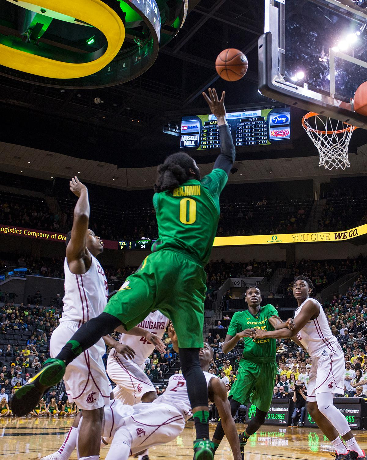 Oregon Ducks' Dwayne Benjamin (#0) lobs the ball toward the basket during the game against the Washington State Cougars. The Ducks beat the Cougars 76-62. Kianna Cabuco, Oregon News Lab