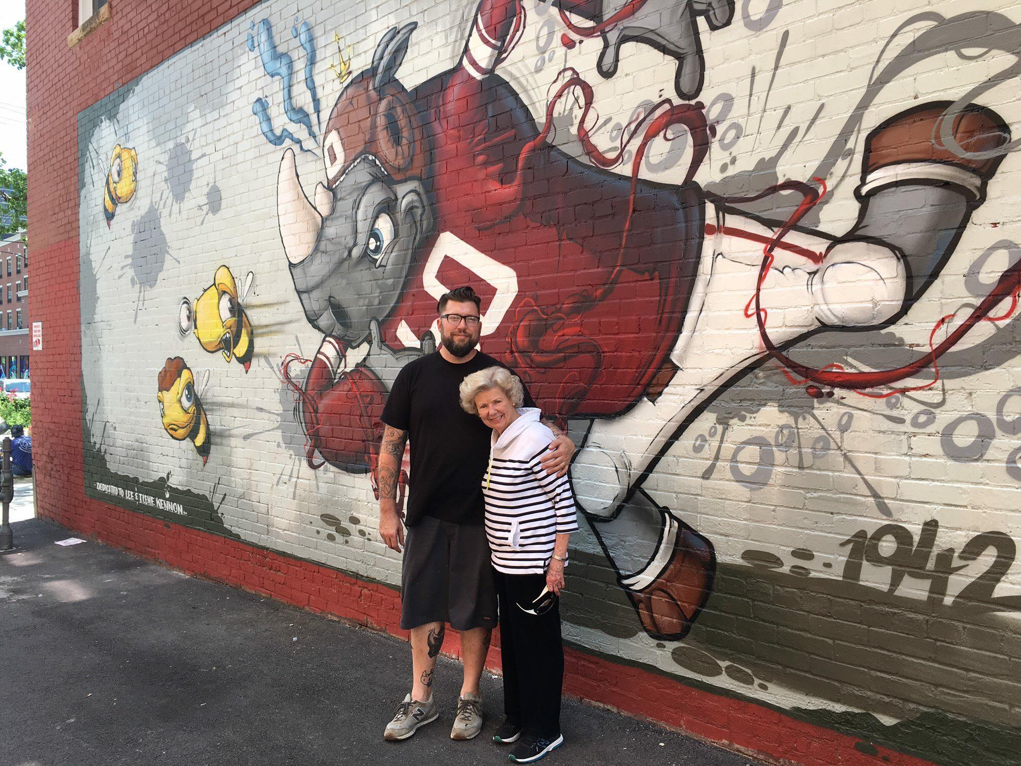 Donald Ross Scribe and his grandmother stand in front of his mural (Courtesy of Scribe).